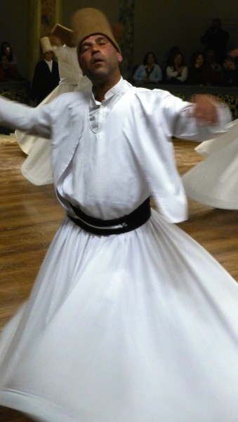 A Whirling Dervish closes his eyes and drifts towards his God © Andrew Gough